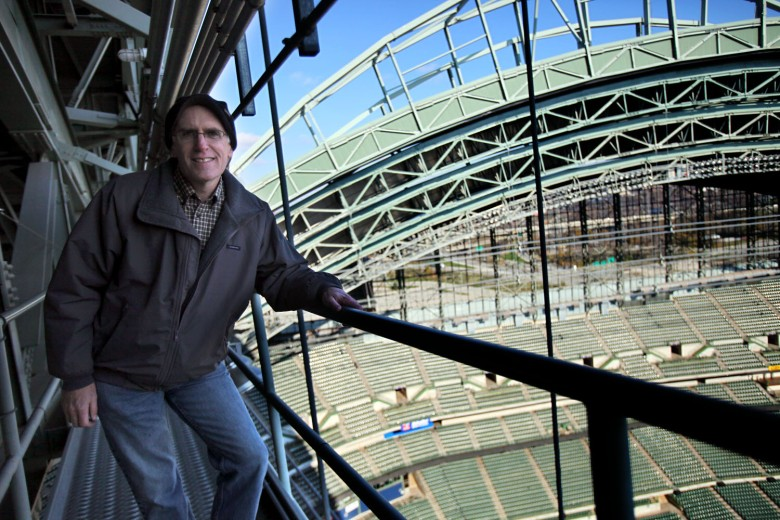 Don Walker poses for a photo on a catwalk during the construction of Miller Park, home of the Milwaukee Brewers.