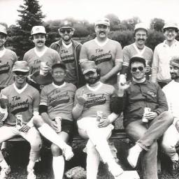 Don Walker (top row, third from left) was on The Milwaukee Journal softball team, photo circa late 1980s. The 'L' sign that everyone is showing is for 'loser,' as in the team lost in the company tournament. Credit: Mike Juley